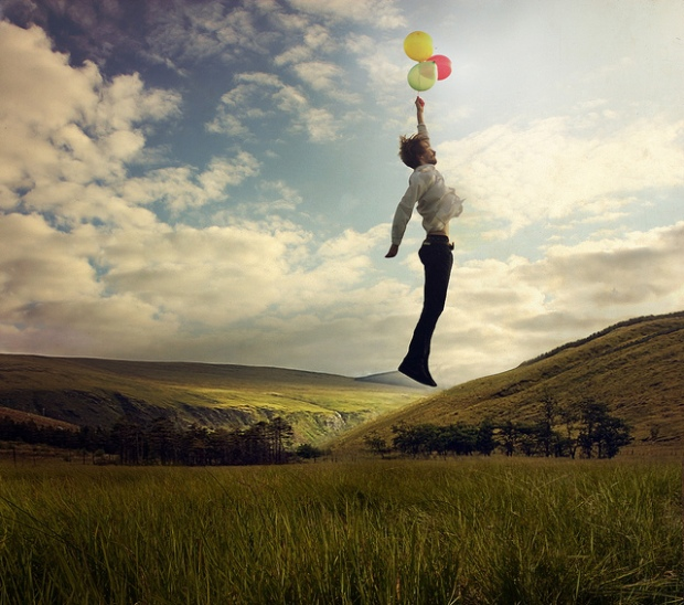 man flying with a balloon